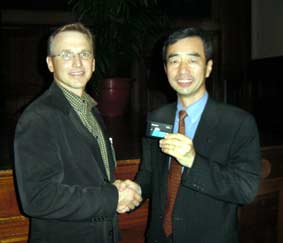 David Krall, CEO, Avid shaking hands with Yoshihiko Yamada, vp Panasonic AVC Network.